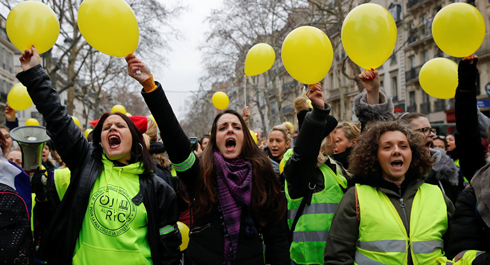 Protesters wearing yellow vests shout slogans as they take part in a demonstration by the Women's yellow vests movement in Paris, France, January 6, 2019.