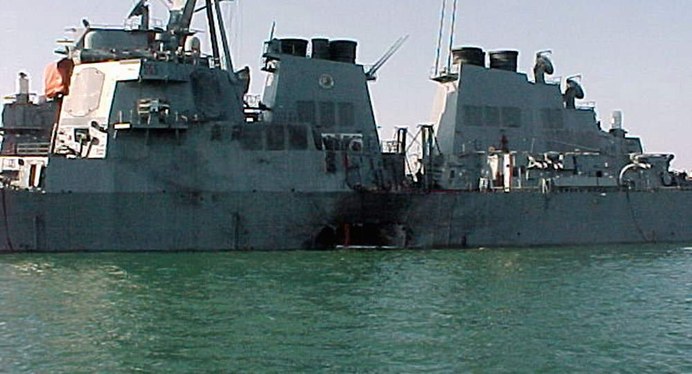 (FILES) This Handout file photo taken October 12, 2000 shows the port side of the guided missile destroyer USS Cole damaged after a suspected terrorist bomb exploded during a refueling operation in the port of Aden in Yemen.