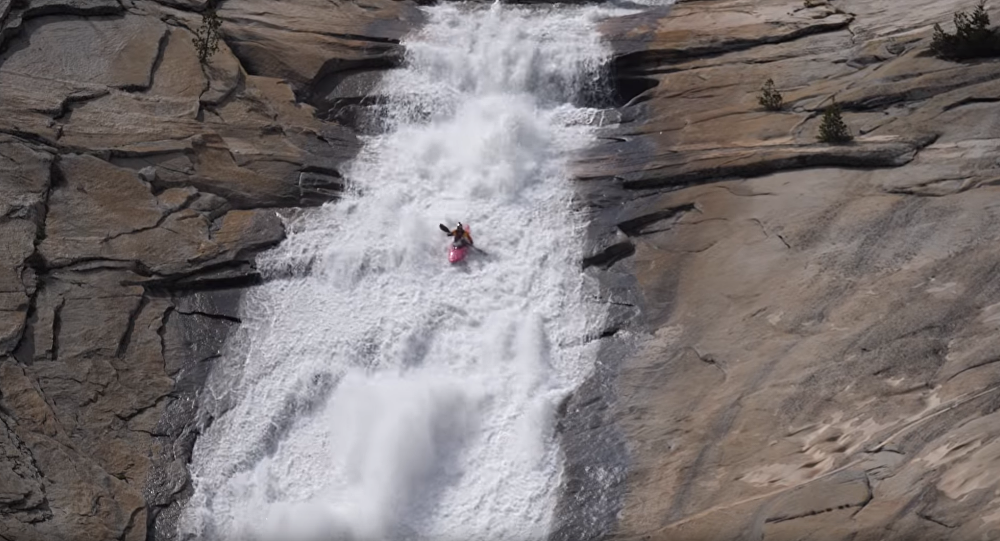 Professional Kayaker Conquers 100-Foot Natural Waterslide