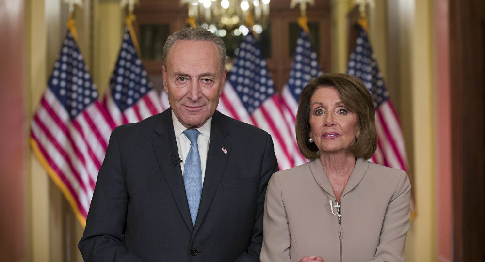 Senate Minority Leader Chuck Schumer of N.Y., and House Speaker Nancy Pelosi of Calif., pose for photographers after speaking on Capitol Hill in response President Donald Trump's address, Tuesday, Jan. 8, 2019, in Washington