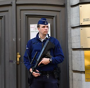 An armed Belgian police officer stands guard outside the Jewish Museum in Brussels after the 2014 attack