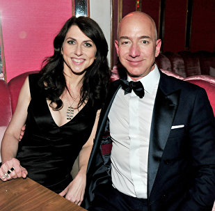 (FILES) In this file photo taken on February 26, 2017 (L-R) CEO of Amazon Jeff Bezos and his wife writer MacKenzie Bezos attend the Amazon Studios Oscar Celebration at Delilah in West Hollywood, California