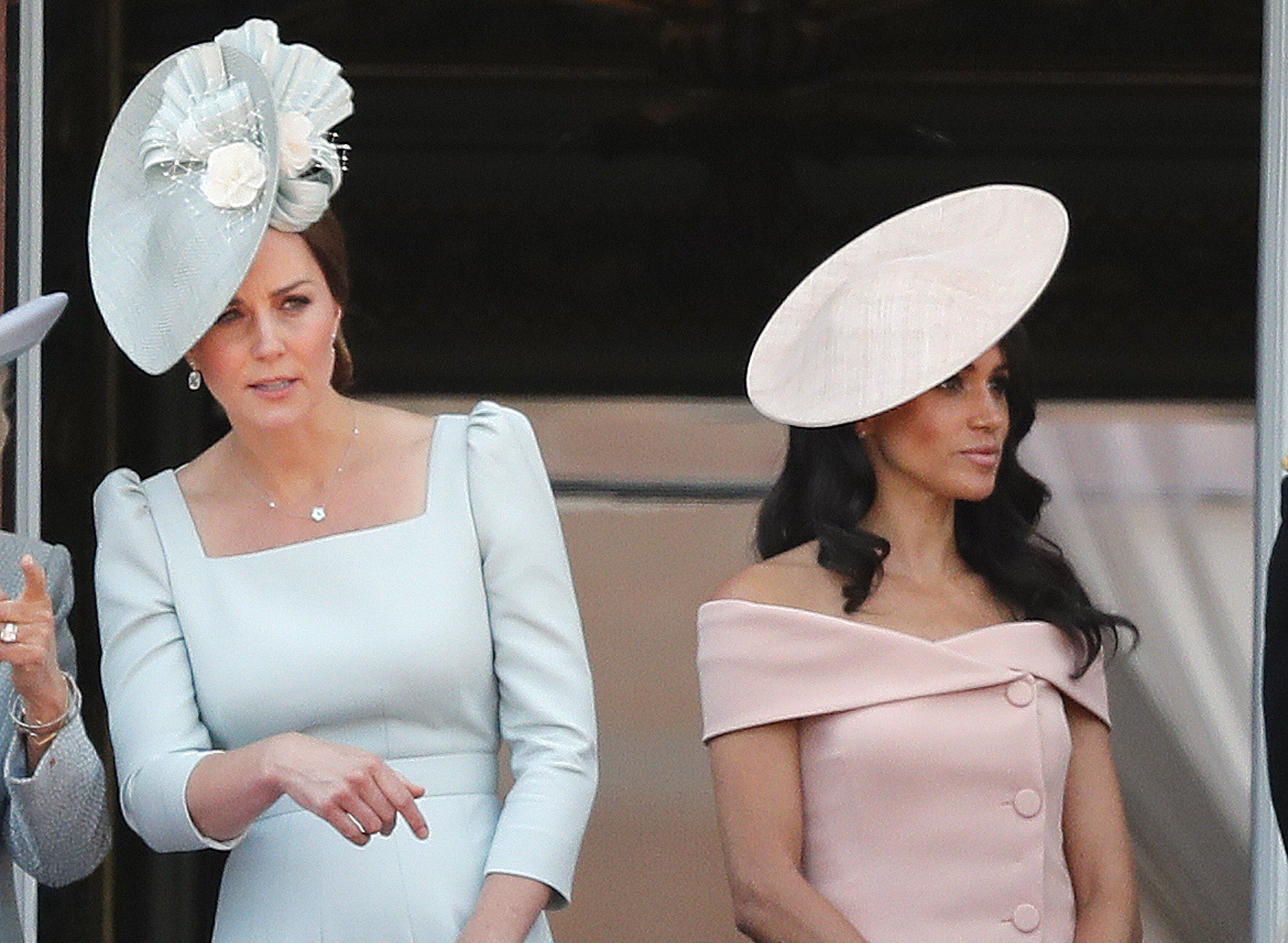 Britain's Kate, the Duchess of Cambridge, left, and Meghan, the Duchess of Sussex attend the annual Trooping the Colour Ceremony in London, Saturday, June 9, 2018.(AP Photo/Frank Augstein)