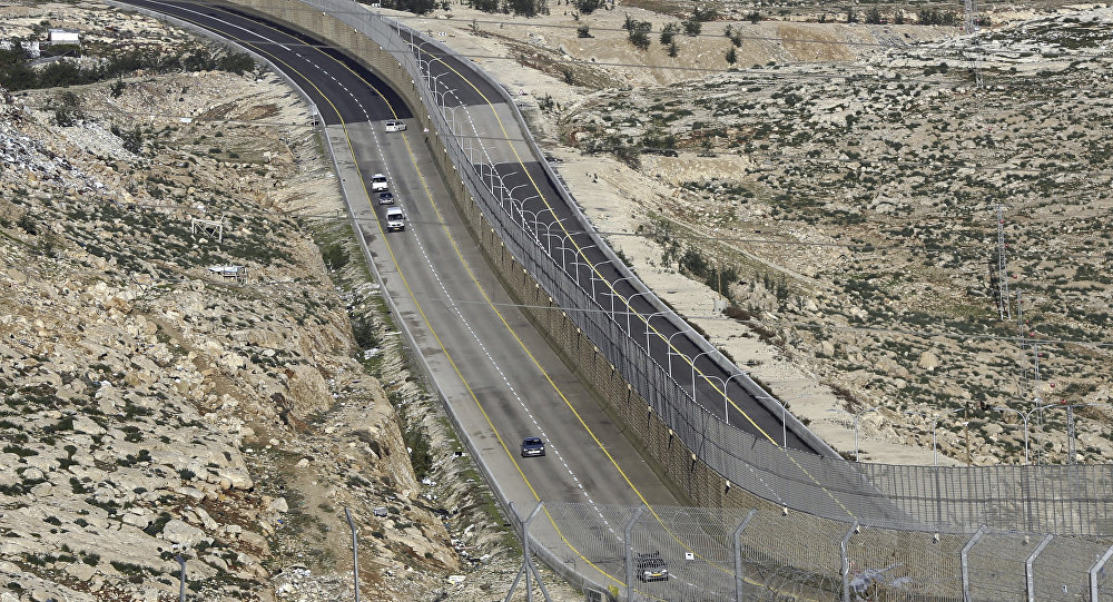 A newly opened segregated West Bank highway, right side of the wall, is seen near Jerusalem Thursday, Jen. 10, 2019.