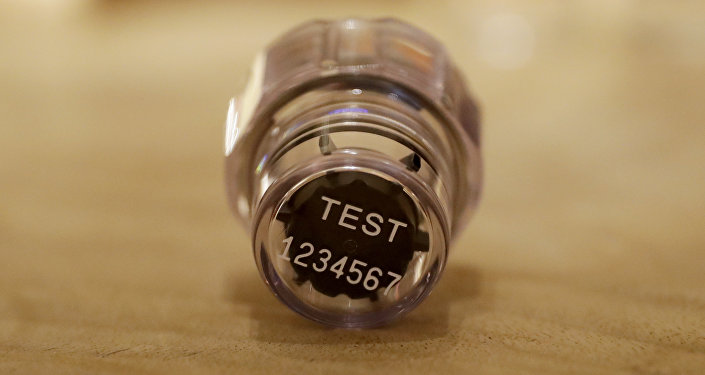 In this Dec. 12, 2016, file photo, an example of a sample bottle lid from the latest Berlinger Special BEREG-Kit for human urine doping testing lies posed for photographs in London. The Swiss manufacturer of the bottles used around the world to hold doping control samples says it is pulling out of the niche industry. Berlinger's withdrawal from the market poses a major headache for anti-doping agencies, who are now scrambling to find alternative suppliers