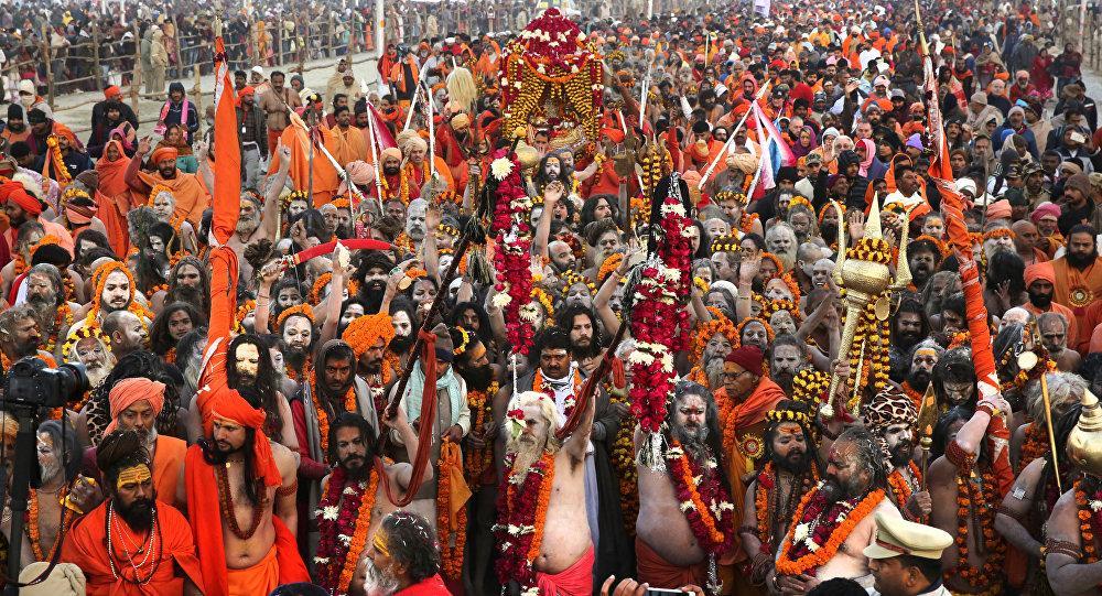 Hindu holy men arrive for ritualistic dip on auspicious Makar Sankranti day during the Kumbh Mela, or pitcher festival in Prayagraj, Uttar Pradesh state, India, Tuesday, Jan.15, 2019.