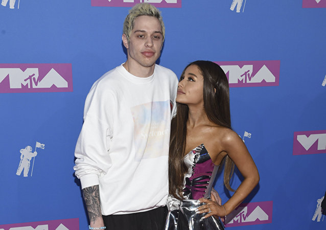 Pete Davidson, left, and Ariana Grande arrive at the MTV Video Music Awards at Radio City Music Hall on Monday, Aug. 20, 2018, in New York
