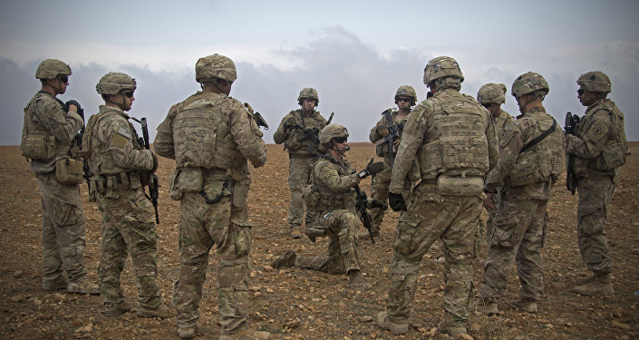 In this 7 November 2018 photo released by the US Army, US soldiers gather for a brief during a combined joint patrol rehearsal in Manbij, Syria