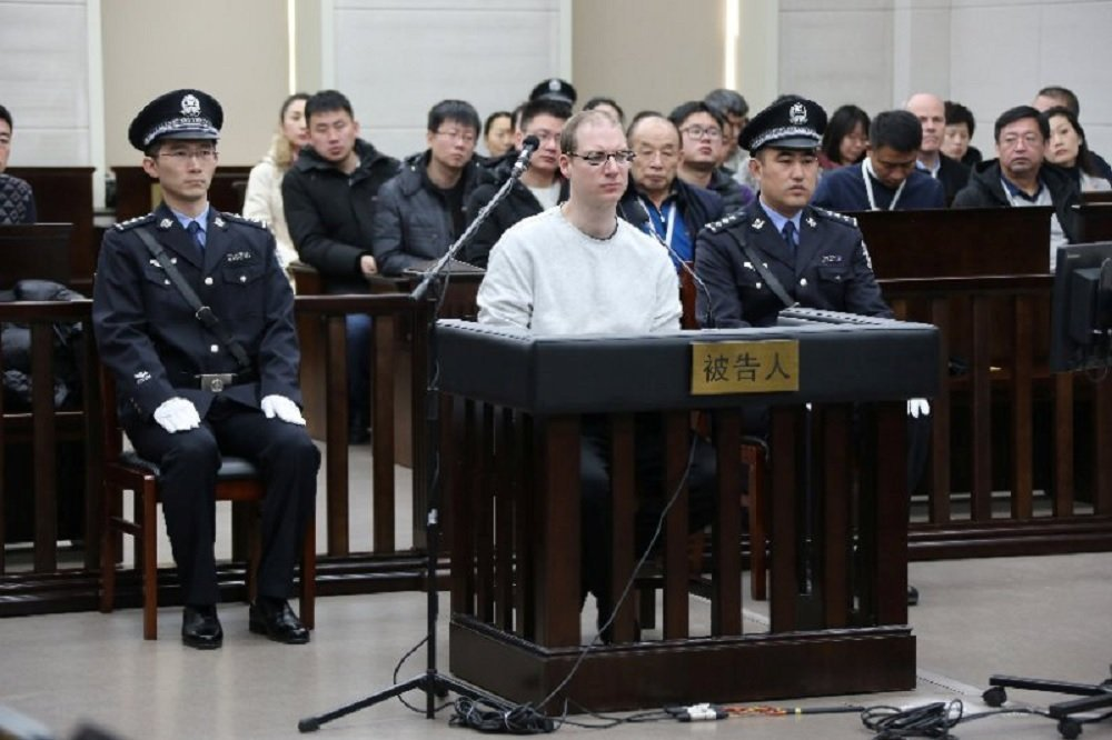 Canadian Robert Lloyd Schellenberg appears in court for a retrial of his drug smuggling case in Dalian, Liaoning province, China, January 14, 2019, in this handout picture received by Reuters January 15, 2019