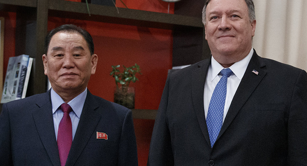 Secretary of State Mike Pompeo, right, and Kim Yong Chol, a North Korean senior ruling party official and former intelligence chief, pose for photographs at the The Dupont Circle Hotel in Washington, Friday, Jan. 18, 2019. (AP Photo/Carolyn Kaster)