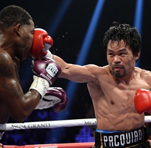 Jan 19, 2019; Las Vegas, NV, USA; Manny Pacquiao (black trunks) and Adrien Broner (purple/gold trunks) box during a WBA welterweight world title boxing match at MGM Grand Garden Arena. Pacquiao won via unanimous decision