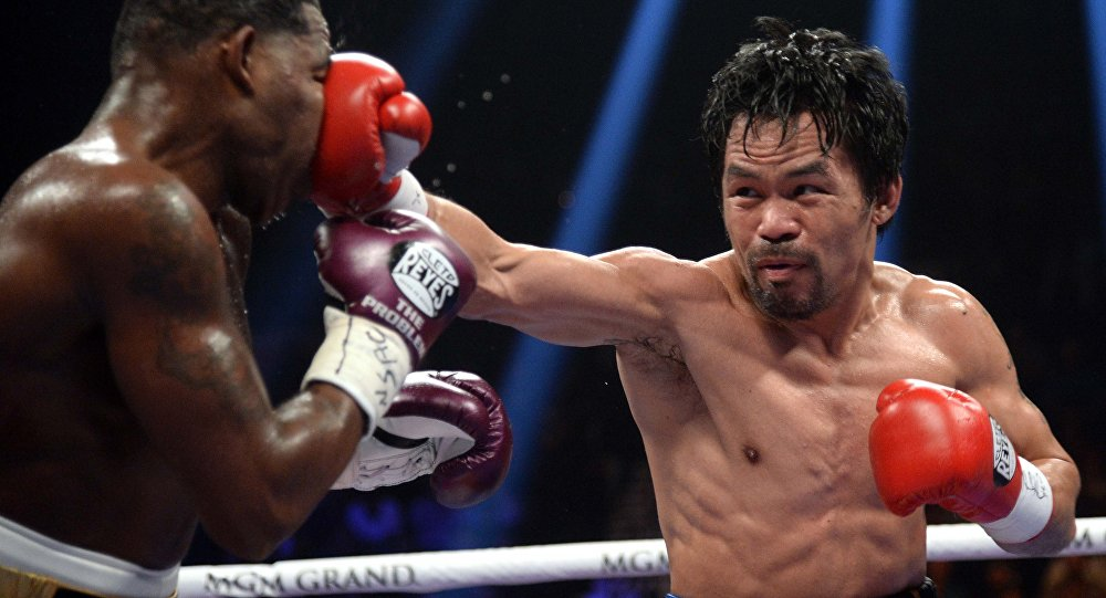 Manny Pacquiao eyes Floyd Mayweather rematch after dominating Adrien Broner