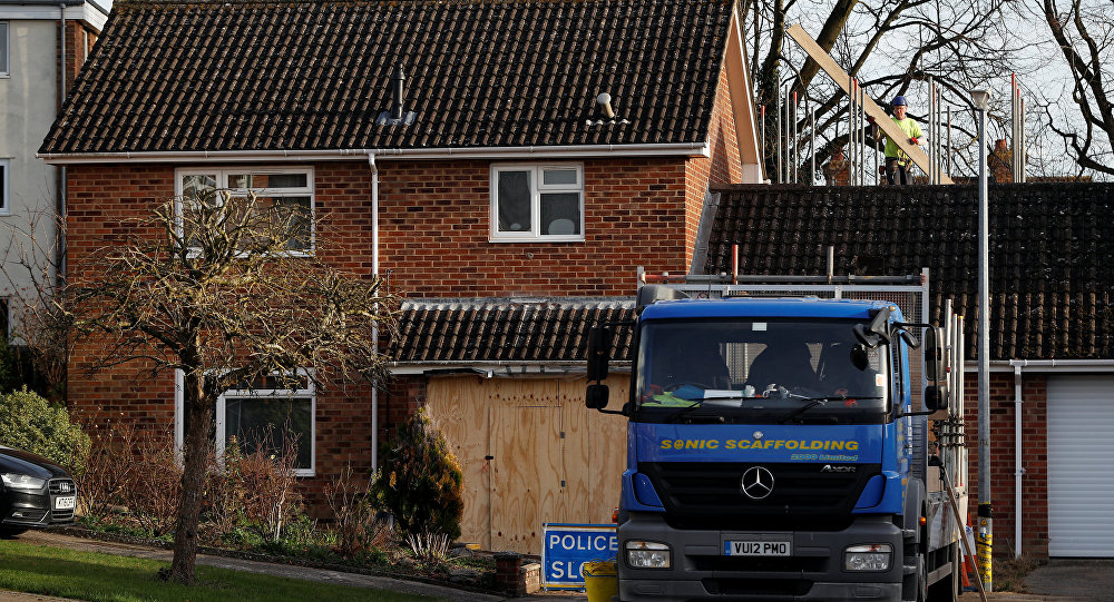 A scaffolder works at the site of former spy Sergei Skripal's house, in Salisbury, Britain January 9, 2019