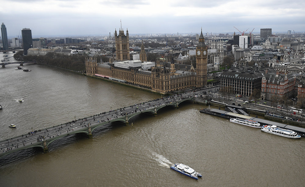 The Palace of Westminster, comprising the House of Commons and the House of Lords, wchich together make up the Houses of Parliament, are pictured on the banks of the River Thames alongside Westminster Bridge in central London on March 29, 2017