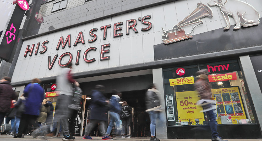 People pass an HMV shop in London