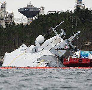 """The Norwegian frigate KNM Helge Ingstad takes on water after a collision with the tanker """"Sola TS"""" on November 10, 2018 in the Hjeltefjord near Bergen"""