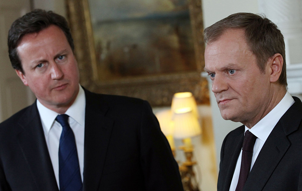 Britain's Prime Minister David Cameron, left, listens to European Council President Donald Tusk.