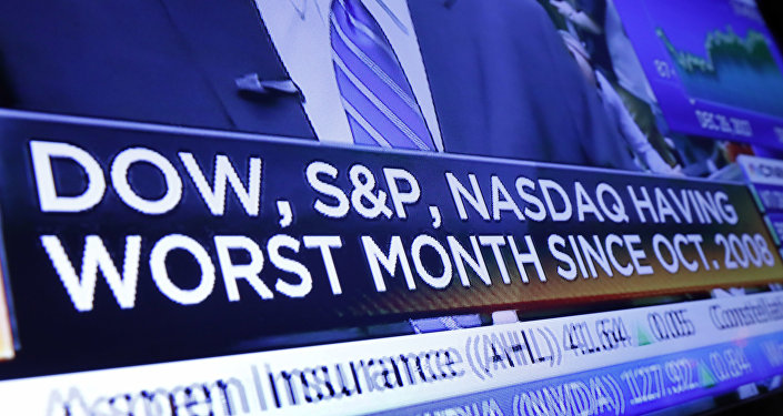 A headline on a television screen on the floor of the New York Stock Exchange