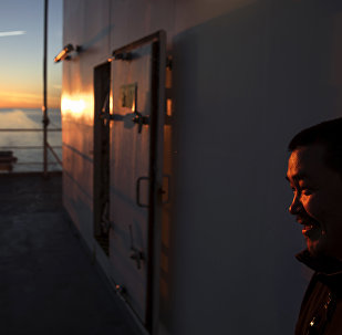 Trainee Maatiusi Manning stands aboard the Finnish icebreaker MSV Nordica as it traverses the Northwest Passage in the Canadian Arctic Archipelago, Thursday, July 27, 2017