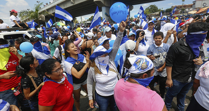 Protestors wave balloons and Nicaraguan flags during an anti-government event coined The March of Balloons in Managua, Nicaragua, Sunday, Sept. 9, 2018. The march aimed to raise awareness of what protesters call political prisoners and demand their release.