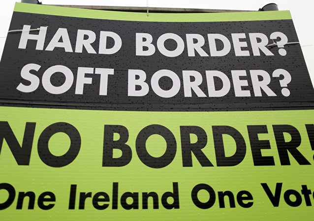 A picture shows a sign calling for no border to be imposed between Ireland and Northern Ireland outside Newry, Northern Ireland, on November 14, 2018 near the Irish border.