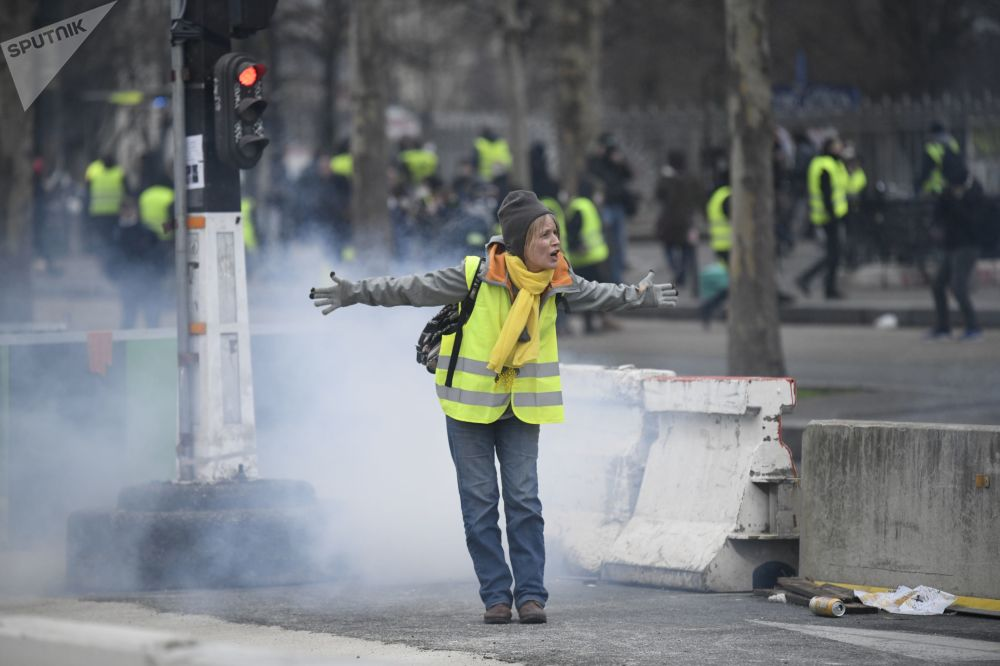 A woman participating in Yellow Vests protests in Paris