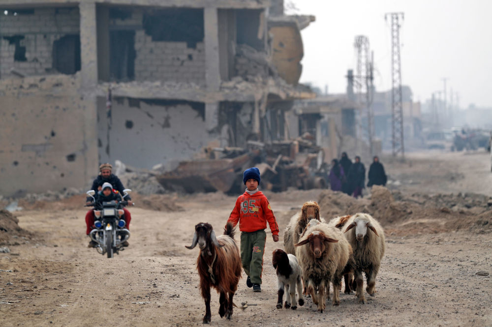 Civilians return to the city of Hajin in Syria's eastern Deir Ez-zor province