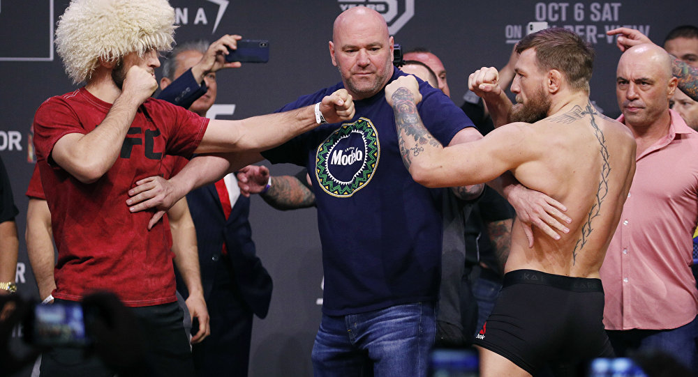 Conor McGregor, right, and Khabib Nurmagomedov face off during a ceremonial weigh-in