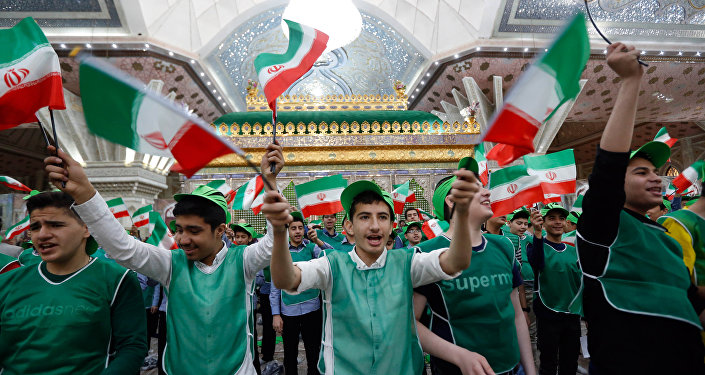 Iranian students wave Iran's national flags around the tomb of Iran's late founder of the Islamic Republic, Ayatollah Ruhollah Khomeini, on the occasion of 40th anniversary of Khomeini's return from exile