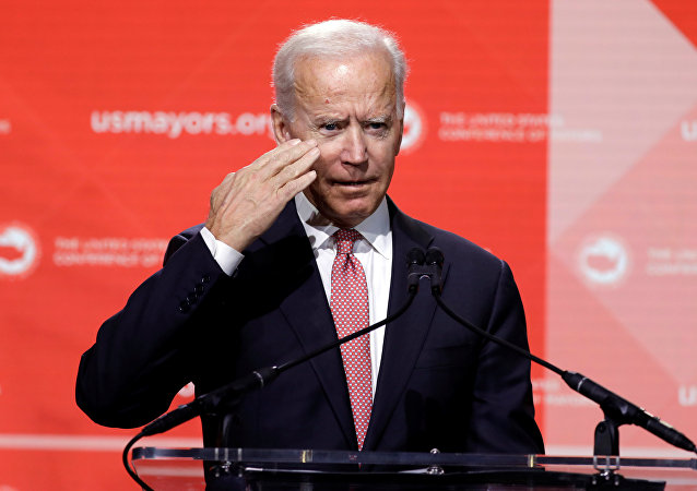 Former U.S. Vice President Joe Biden salutes to the audience at the United States Conference of Mayors winter meeting in Washington, U.S., January 24, 2019