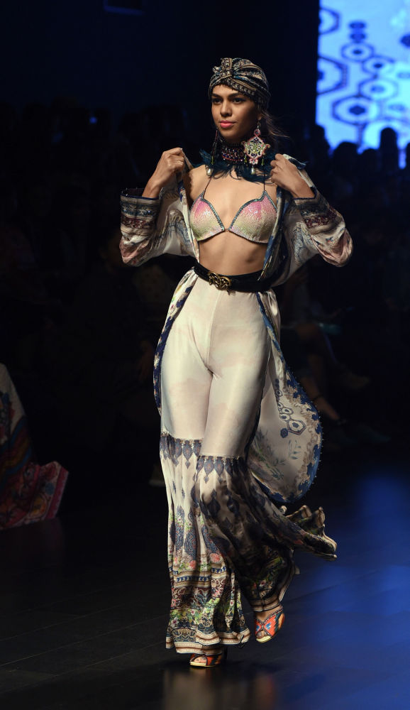 Indian Model on Stage Wearing Clothes Created by Rajdeep Ranawat at the Lakme Fashion Week in Mumbai