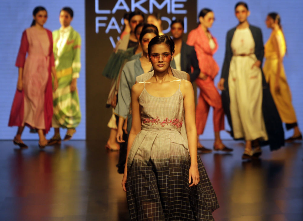 Indian Models on Stage Wearing Clothes Created by Tahweave at the Lakme Fashion Week in Mumbai