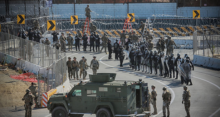 United States Military personel and Border Patrol agents secure the United States-Mexico border on November 25, 2018 at the San Ysidro border crossing point south of San Diego, California.