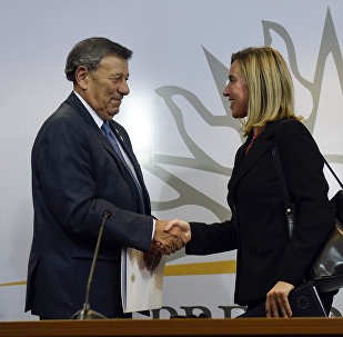 "Uruguay's Foreign Affairs Minister Rodolfo Nin, left, and European Union foreign policy chief Federica Mogherini shake hands at the end of an ""International Contact Group"" meeting regarding the ongoing Venezuelan crisis, in Montevideo, Uruguay,Thursday, Feb. 7, 2019. Uruguayan President Tabare Vazquez is leading the meeting attended by leaders of 14 countries, including Spain, Italy, Portugal and Sweden."