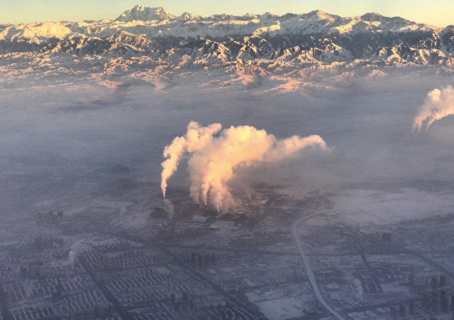 smoke stacks near the city of Urumqi China's northwestern region of Xinjiang