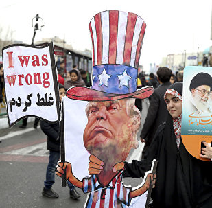 An Iranian woman holds an effigy of US president Donald Trump, during a rally marking the 40th anniversary of the 1979 Islamic Revolution, in Tehran, Iran, Monday, Feb. 11, 2019