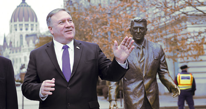US Secretary of State, Mike Pompeo, is pictured next to a scuplture of former US President Ronald Reagan at the Liberty square (Szabadsag) in Budapest, Hungary, Feb. 11, 2019