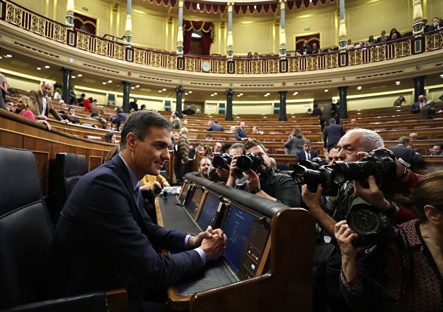 Spain's Prime Minister Pedro Sanchez is photographed at the Spanish parliament in Madrid, Wednesday, Feb. 13, 2019