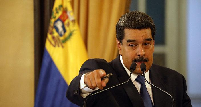 Venezuela's President Nicolas Maduro gestures during a news conference at Miraflores Palace in Caracas, Venezuela, 8 February , 2019