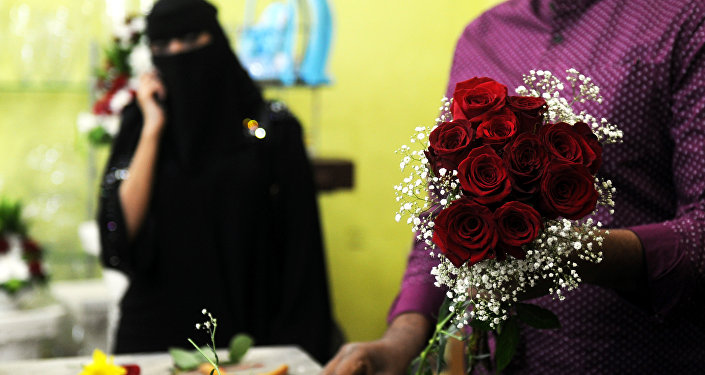 A florist prepares a Valentine's Day bouquet of flowers for a Saudi client at a flower shop in Jeddah on February 14, 2018