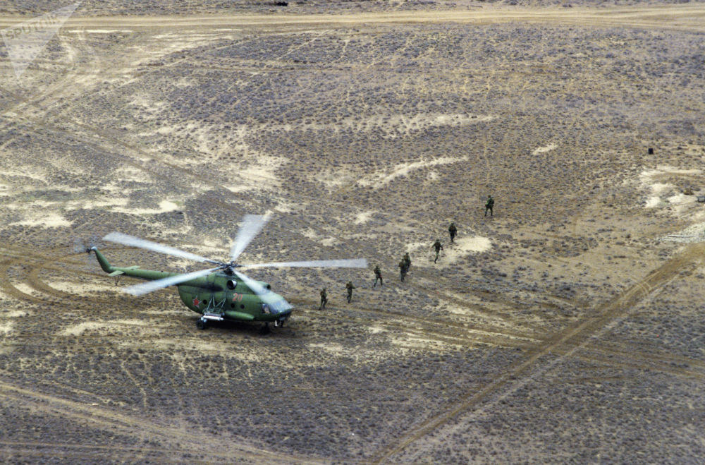 The Limited Contingent of Soviet Troops in Afghanistan lands troops in the Hindu Kush mountains.