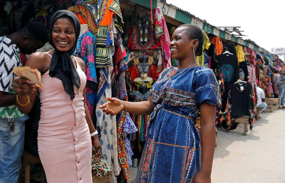 Clothes Sellers Exchange Money in Marina, Nigeria