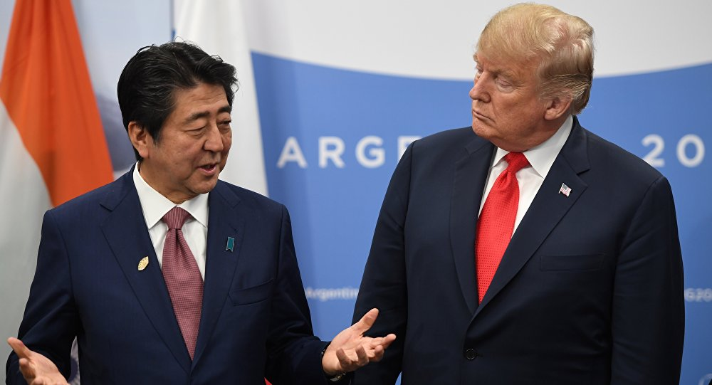 Japan's Prime Minister Shinzo Abe speaks with US President Donald Trump during a meeting in the sidelines of the G20 Leaders' Summit in Buenos Aires, on November 30, 2018