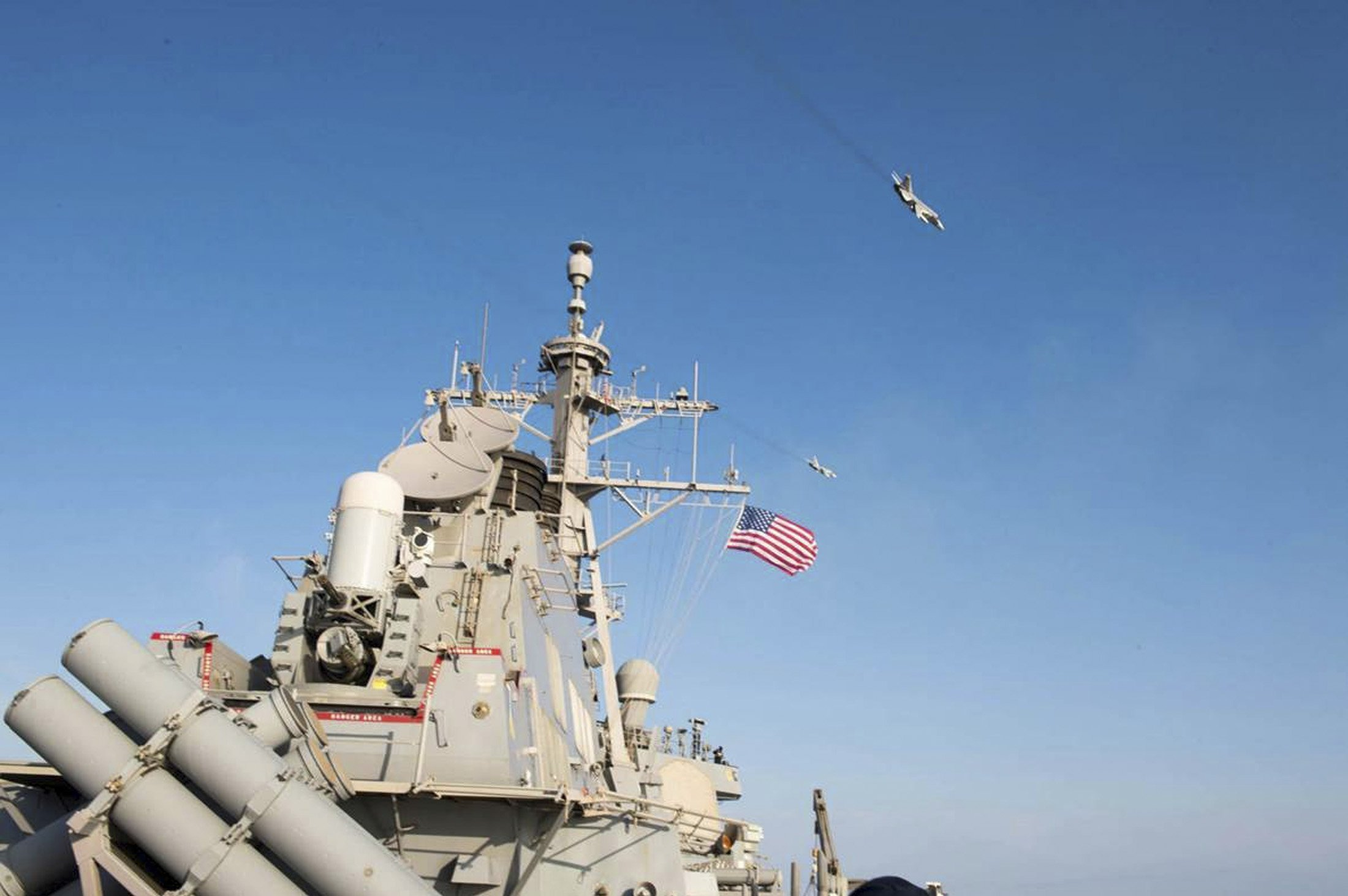 An U.S. Navy picture shows what appears to be a Russian Sukhoi SU-24 attack aircraft flying over the U.S. guided missile destroyer USS Donald Cook in the Baltic Sea in this picture taken April 12, 2016 and released April 13, 2016
