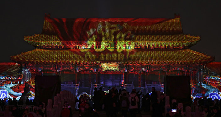 Visitors tour the Forbidden City projected with colorful lights during the Lantern Festival in Beijing, Tuesday, Feb. 19, 2019. Beijing's Palace Museum was illuminated and opened for night visits to celebrate China's Lantern Festival.