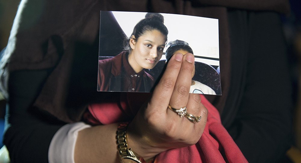 In this file photo taken on February 22, 2015 Renu Begum, eldest sister of missing British girl Shamima Begum, holds a picture of her sister while being interviewed by the media in central London.