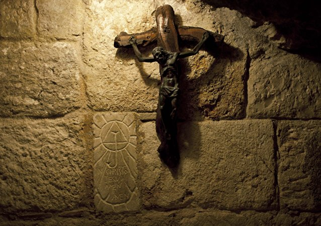 In this Tuesday Dec. 10, 2013 photograph, a crucifix is seen in the St. Jerome's Cave underneath the Church of the Nativity in the West Bank city of Bethlehem.