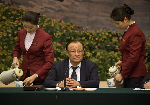 Shohrat Zakir, chairman of the Xinjiang Uyghur Autonomous Region, prepares to describe the mass internment of ethnic minority Muslims in the country's far west as a system of training centers that saves Muslims from religious extremism by teaching them to speak Mandarin and accept modern science