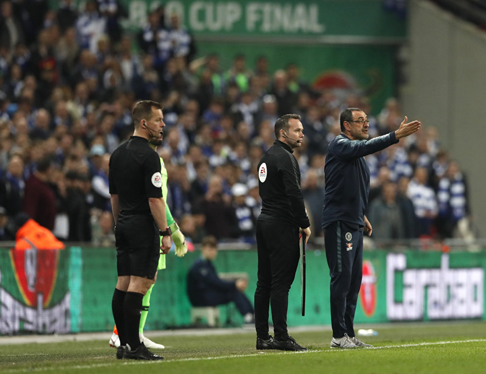 Chelsea's under pressure manager Maurizio Sarri gesticulates as he tries to make the substitution on 24 February 2019