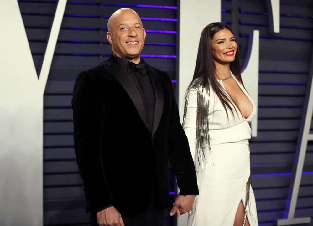 Actor Vin Diesel and Paloma Jimenez pose for a photo at the 2019 Vanity Fair Oscar Party